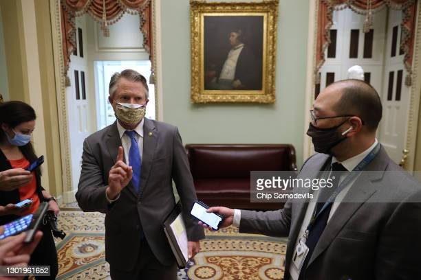 Sen. Roger Marshall talks to reporters outside the Senate Chamber for the fifth day of former President Donald Trump's impeachment trial at the U.S....