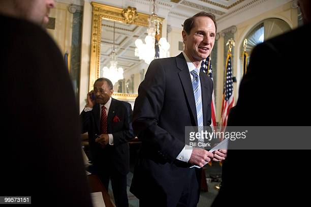 Sen Roland Burris DIll left talks on his cell phone as Sen Ron Wyden DOre speaks with participants in the the news conference on Wednesday March 3 to...