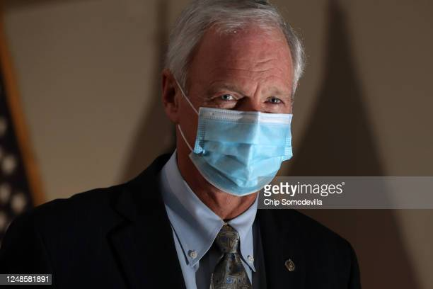 Sen Ron Johnson arrives for the weekly Senate Republican policy luncheon in the Hart Senate Office Building on Capitol Hill June 09 2020 in...