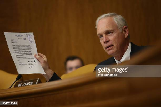 Sen Ron Johnson questions Congressional Budget Office Director Keith Hall during Hall's testimony before the Senate Budget Committee January 24 2018...