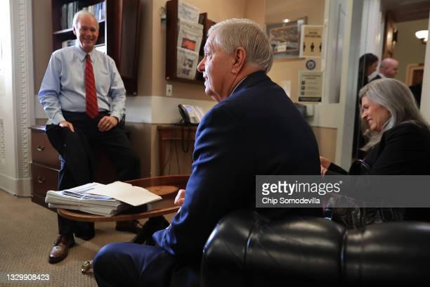 Sen. Ron Johnson , Sen. Lindsey Graham and Sen. Joni Ernst prepare for a news conference at the U.S. Captiol on July 21, 2021 in Washington, DC....