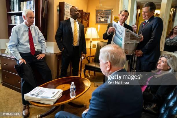 Sen. Ron Johnson , Sen. Tim Scott , Sen. John Barrasso , Sen. Steve Daines, Sen. Lindsey Graham , center, and Sen. Joni Ernst talk with each other...