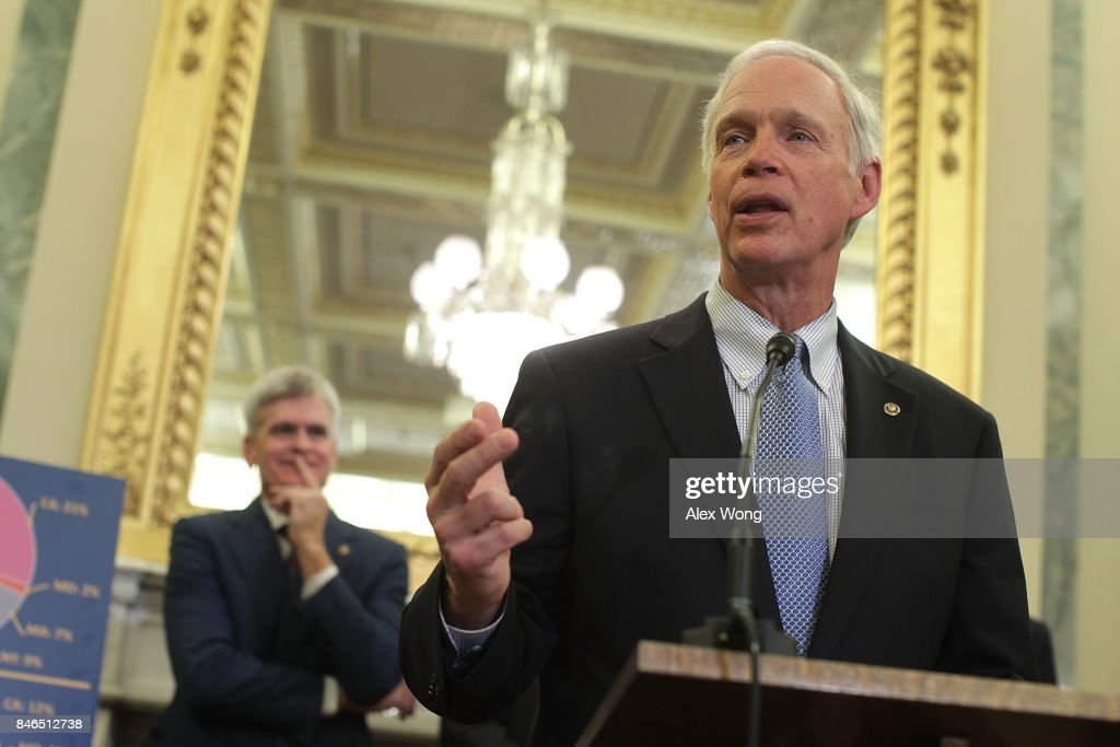 U.S. Sen. Ron Johnson (R-WI) (R) speaks as Sen. Bill Cassidy (R-LA) (L) listens during a news conference on health care September 13, 2017 on Capitol Hill in Washington, DC. Senators Graham, Cassidy, Heller and Johnson unveiled a proposed legislation to repeal and replace the Obamacare.