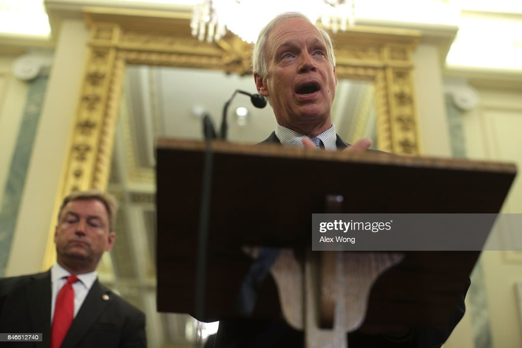 U.S. Sen. Ron Johnson (R-WI) (R) speaks as Sen. Dean Heller (R-NV) (L) listens during a news conference on health care September 13, 2017 on Capitol Hill in Washington, DC. Senators Graham, Cassidy, Heller and Johnson unveiled a proposed legislation to repeal and replace the Obamacare.