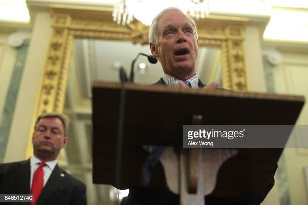 Sen. Ron Johnson speaks as Sen. Dean Heller listens during a news conference on health care September 13, 2017 on Capitol Hill in Washington, DC....