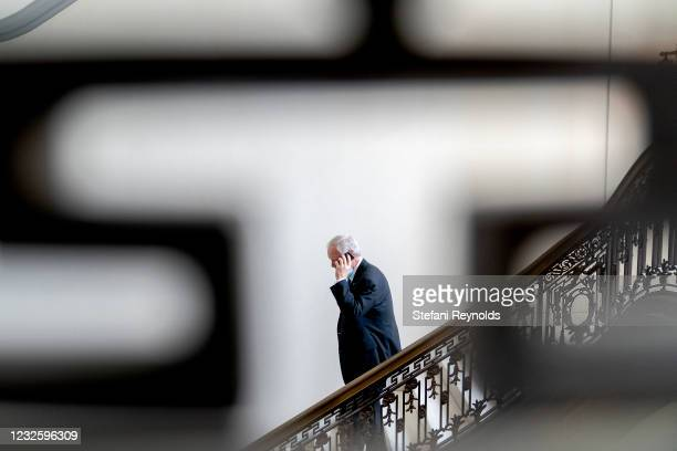 Sen. Ron Johnson speaks on the phone while departing Senate Republican policy luncheons at the Russell Senate Office Building on April 29, 2021 in...