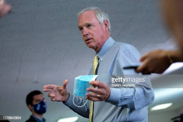 S Sen Ron Johnson speaks to members of the media as he arrives for the weekly Senate Republican policy luncheon in the Hart Senate Office Building on...