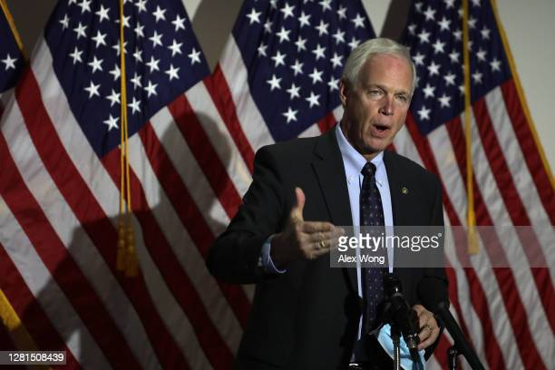 Sen. Ron Johnson speaks to members of the press at Hart Senate Office Building October 21, 2020 on Capitol Hill in Washington, DC. The Senate failed...