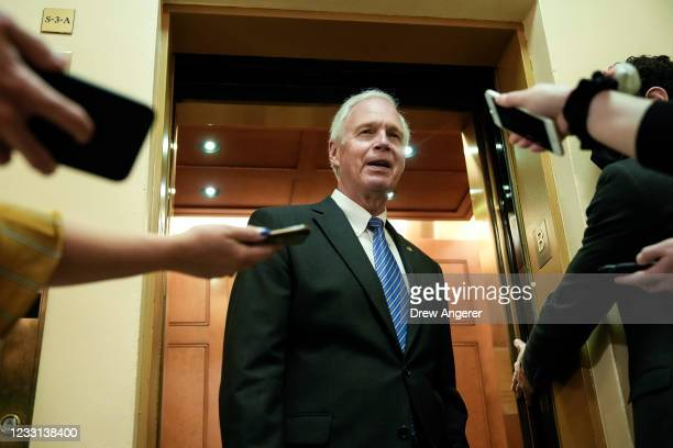 Sen. Ron Johnson speaks to reporters and tells them why he is against a January 6 commission on his way to a vote at the U.S. Capitol May 27, 2021 in...