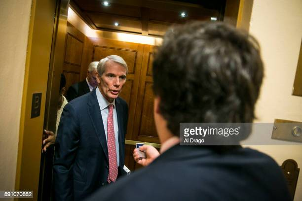 S Sen Ron Johnson speaks with reporters as he arrives for the weekly Senate Republican's policy luncheon on Capitol Hill December 12 2017 in...
