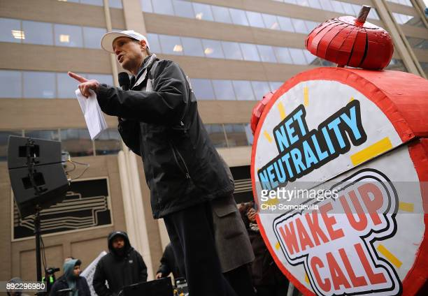 Sen Ron Wyden addresses protesters outside the Federal Communication Commission building to rally against the end of net neutrality rules December 14...