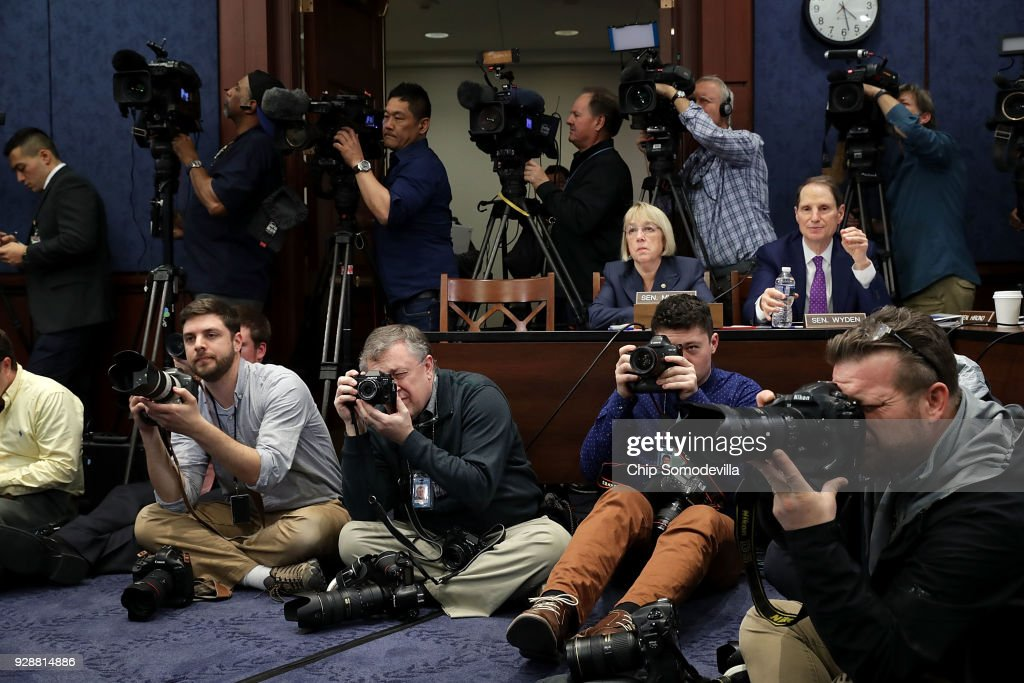 Sen. Ron Wyden (D-OR) (R) and Sen. Patty Murray (D-WA) (2nd R) are surrounded by journalists during a meeting about gun violence in the visitors center at the U.S. Capitol March 7, 2018 in Washington, DC. Senate Democrats called the meeting to hear from people who they said were missing from the debate on guns, including the parents of young gun violence victims from Florida, Virginia and Connecticut; law enforcement officials; students and teachers.