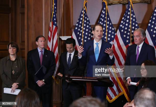 Sen Ron Wyden is flanked by Amy Klobuchar Richard Blumenthal Brian Schatz Ed Markey and Tammy Duckworth while speaking about a Congressional Review...