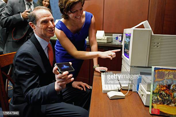 S Sen Ron Wyden shows off a current version of the computer game Oregon Trail on his iPhone while playing the the original version on an Apple IIGS...