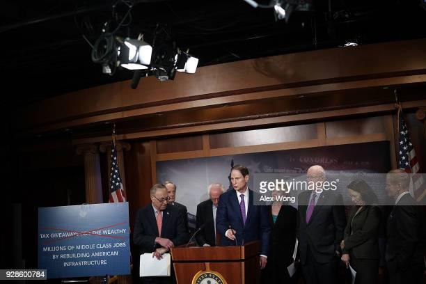 Sen. Ron Wyden speaks as Senate Minority Leader Sen. Chuck Schumer , Sen. Tom Carper , Sen. Bernie Sanders , Sen. Debbie Stabenow , Sen. Pat Leahy ,...
