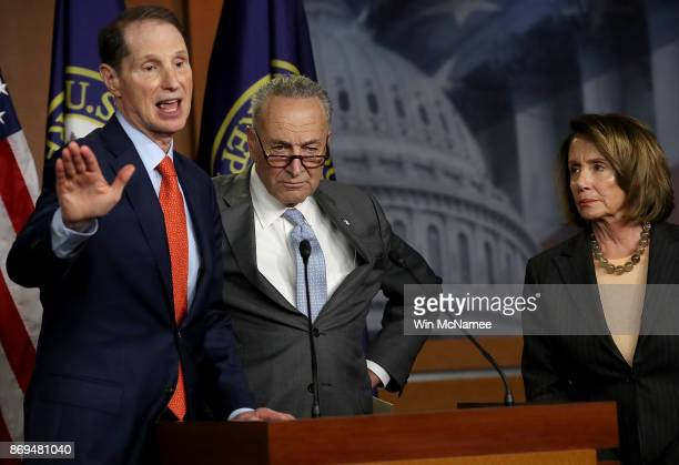 Sen Ron Wyden speaks during a press conference where congressional Democrats reacted to the newly introduced Republican tax reform proposal November...