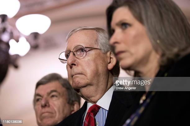 Sen Roy Blunt Senate Majority Leader Mitch McConnell and Sen Joni Ernst look on during a press conference following the weekly Republican policy...