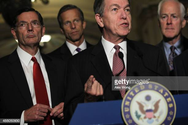 S Sen Roy Blunt speaks to members of the media as Sen John Barrasso Sen John Thune and Senate Minority Whip Sen John Cornyn listen after the Senate...