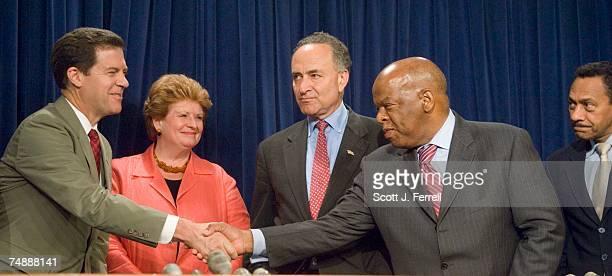 Sen Sam Brownback RKan Sen Debbie Stabenow DMich Sen Charles E Schumer DNY Rep John Lewis DGa and Rep Melvin Watt DNC during a news conference...