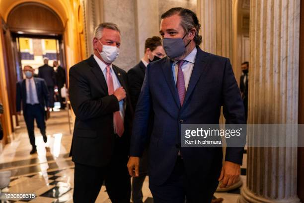 Sen. Senator Roger Marshall and Sen. Ted Cruz walk off the floor of the Senate chamber on Capitol Hill on Tuesday, Jan. 26, 2021 in Washington, DC.