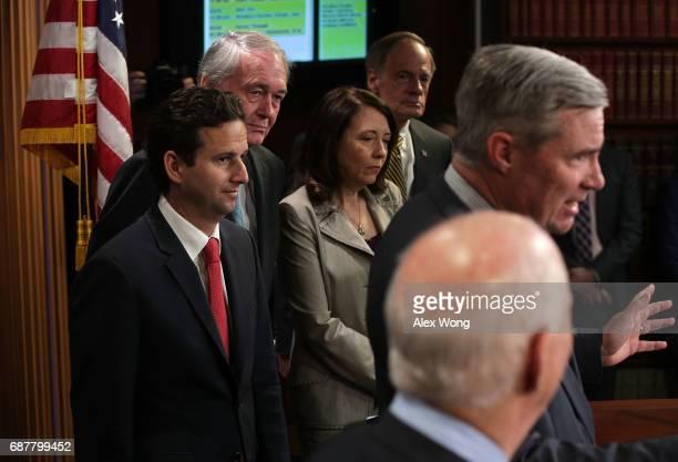 Sen. Sheldon Whitehouse speaks as Sen. Brian Schatz , Sen. Edward Markey , Sen. Maria Cantwell and Sen. Tom Carper listen during a news conference at...
