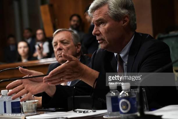 S Sen Sheldon Whitehouse speaks as Senate Minority Whip Sen Richard Durbin listens during a markup hearing before the Senate Judiciary Committee...
