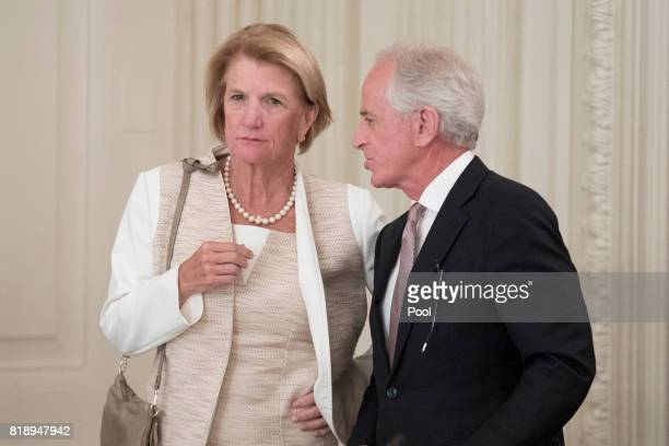 Sen Shelley Moore Capito and Sen Bob Corker speak with one another before the start of a lunch with members of Congress hosted by US President Donald...