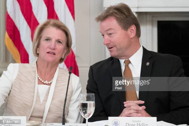 Sen Shelley Moore Capito and Sen Dean Heller speak with one another before the start of a lunch with members of Congress hosted by US President...