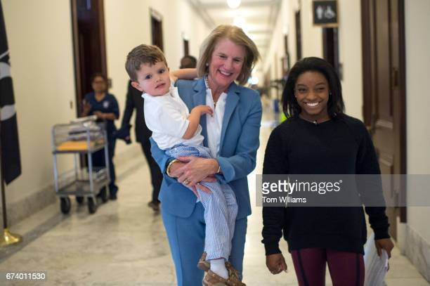 Sen. Shelley Moore Capito, R-W.Va., her grandson Charlie and Simone Biles, an Olympic gold medalist in gymnastics, walk to a Foundation for Advancing...