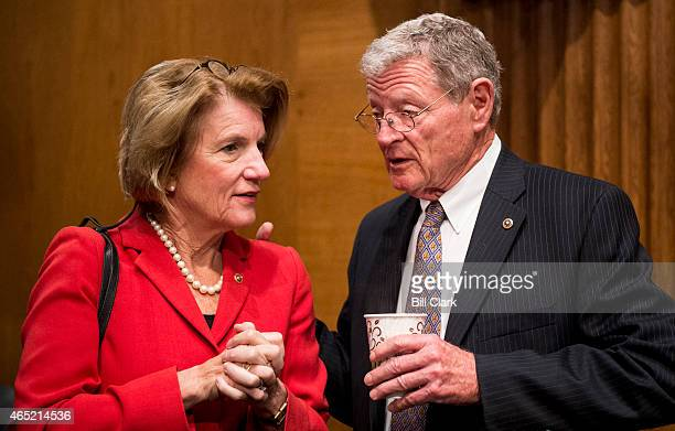 Sen Shelley Moore Capito RWVa speaks with chairman James Inhofe ROkla before the start of the Senate Environment and Public Works Committee hearing...