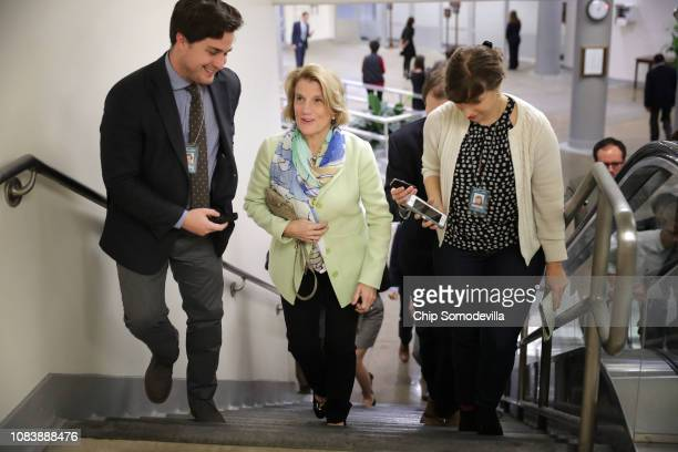 Sen Shelley Moore Capito talks to reporters as she heads to the US Capitol to a procedural vote on a bipartisan criminal reform bill called the...
