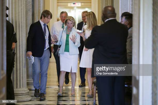 Sen Shelley Moore Capito talks with reporters after leaving the weekly Senate Republican policy luncheon and heads for a vote at the US Capitol July...