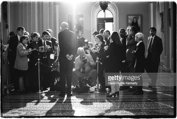 Sen Slade Gorton of Washington speaks with reporters in the hallway of the US Capitol Building on the day the Senate voted to acquire President Bill...