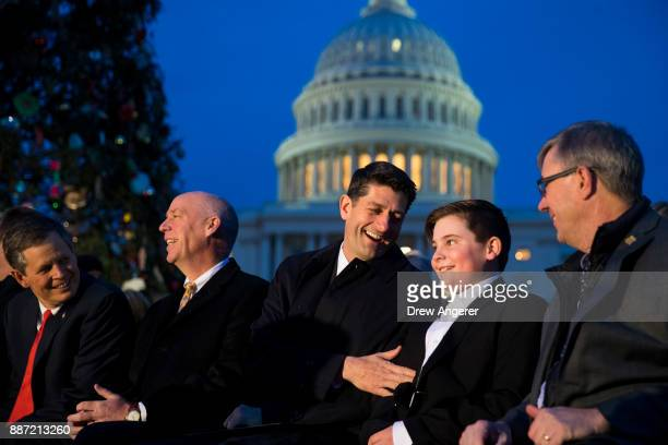 Sen Steve Daines Rep Greg Gianforte Speaker of the House Paul Ryan and Ridley Brandmayr the 11yearold from Bozeman Montana who was chosen to light...