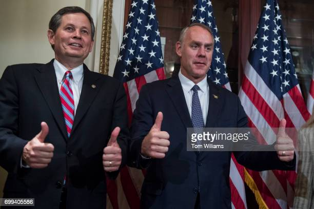 Sen Steve Daines RMont left and Interior Secretary Ryan Zinke attend a swearing in ceremony for Rep Greg Gianforte RMont in the Capitol before the...