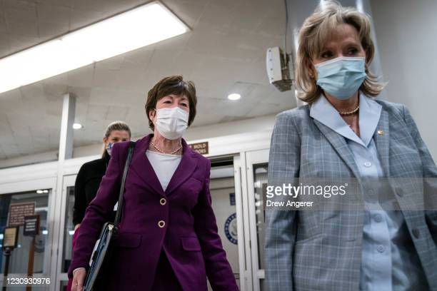 Sen. Susan Collins and Sen. Cindy Hyde-Smith walk through the Senate subway on their way to a vote at the U.S. Capitol on February 2, 2021 in...
