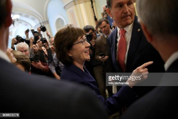 Sen Susan Collins and Sen Joe Manchin gather with a bipartisan group of senators in the US Capitol following a key vote to end the shutdown of the...