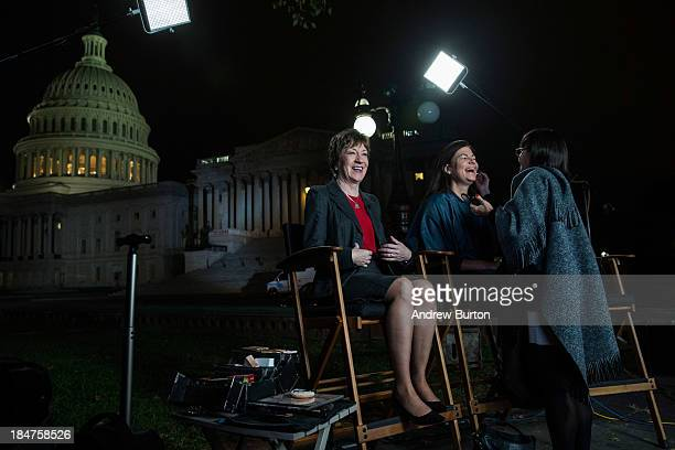 Sen Susan Collins and Sen Kelly Ayotte prepare to appear on national television together on the morning of October 16 2013 in Washington DC Today...