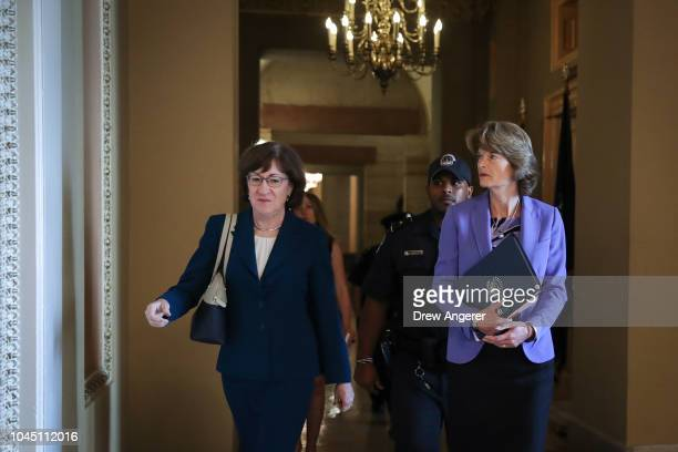 Sen. Susan Collins and Sen. Lisa Murkowski walk together as they arrive to a closed-door lunch meeting of GOP Senators at the U.S. Capitol, October...