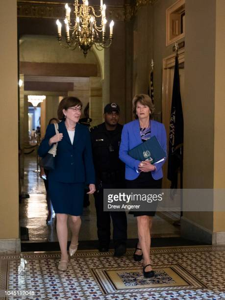 Sen Susan Collins and Sen Lisa Murkowski walk together as they arrive to a closeddoor lunch meeting of GOP Senators at the US Capitol October 3 2018...