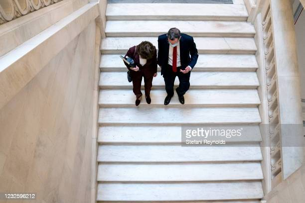 Sen. Susan Collins and U.S. Sen. John Barrasso depart Senate Republican policy luncheons at the Russell Senate Office Building on April 29, 2021 in...