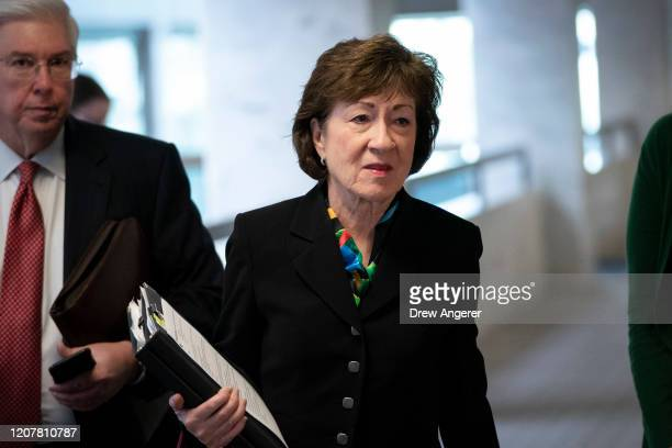 Sen. Susan Collins arrives for a meeting with a select group of Senate Republicans, Senate Democrats, and Trump administration officials in the Hart...