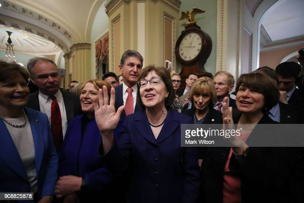 Sen Susan Collins celebrates with fellow Senators after the Senate voted and passed the a CR to reopen the government at the US Capitol on January 22...
