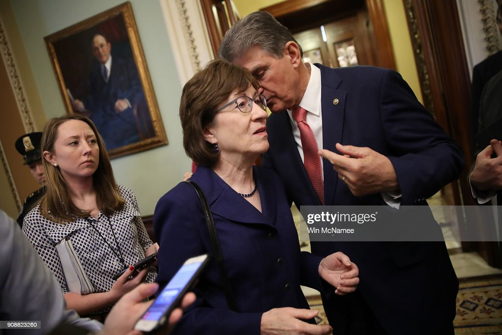 Sen. Susan Collins (R-ME) (L) confers with Sen. Joe Manchin (R) (D-WV) following a key vote to end the shutdown of the federal goverment January 22, 2018 in Washington, DC. The U.S. Senate has voted to end the shutdown, and Congress will now need to wait for the House of Representatives to approve the legislation approved by the Senate.