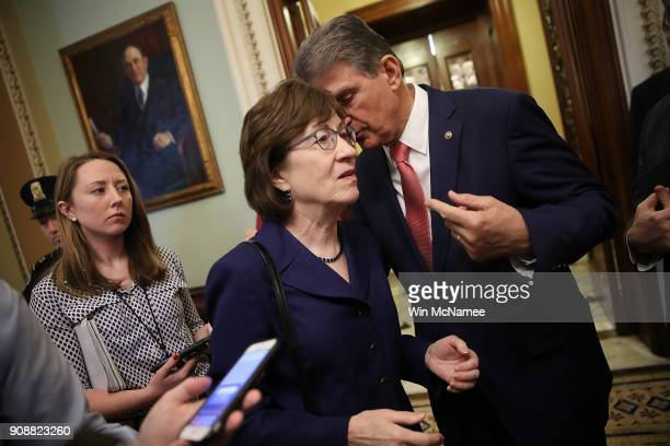 Sen. Susan Collins confers with Sen. Joe Manchin following a key vote to end the shutdown of the federal goverment January 22, 2018 in Washington,...