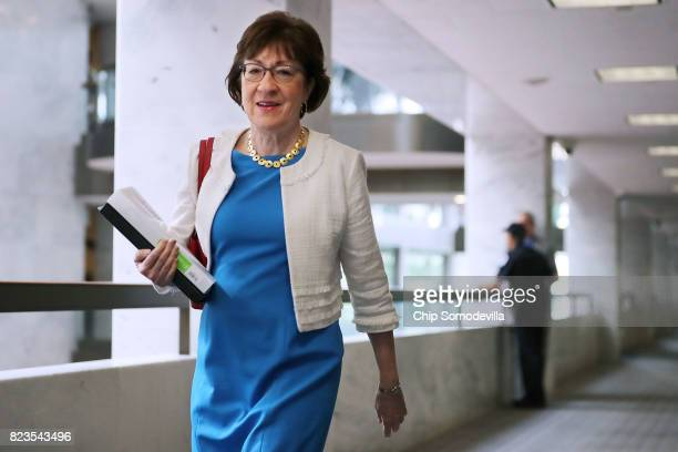 Sen. Susan Collins heads to a closed-door meeing of the Senate Intelligence Committee in the Hart Senate Office Building on Capitol Hill July 27,...