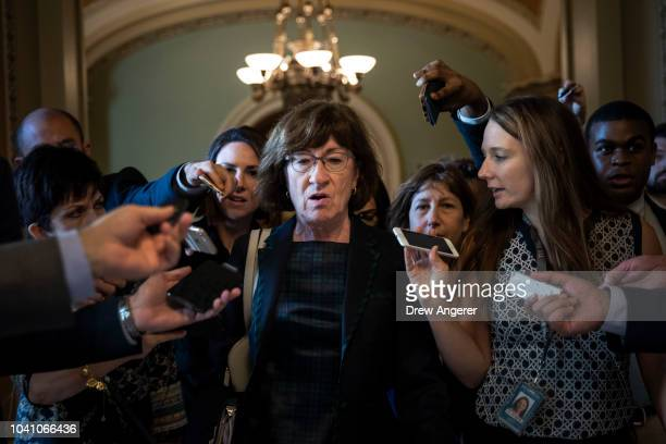 Sen. Susan Collins is surrounded by reporters following a closed-door meeting of Senate Republicans on Capitol Hill, September 26, 2018 in...