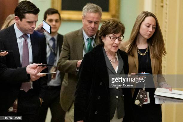 Sen. Susan Collins is trailed by reporters as she at the U.S. Capitol before the Senate impeachment trial of President Donald Trump on Capitol Hill...