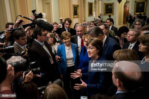 Sen. Susan Collins leads a group of bipartisan Senators as they speak to reporters after the Senate passed a procedural vote for a continuing...