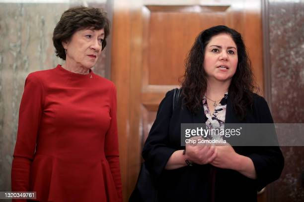 Sen. Susan Collins listens to Sandra Garza, girlfriend of the late Capitol Police officer Brian Sicknick, as they express their support for a January...
